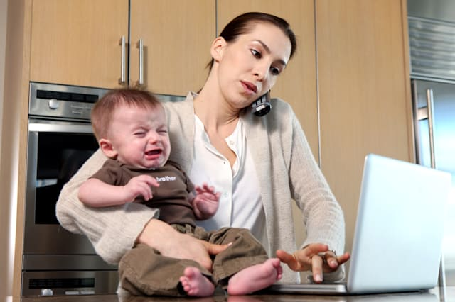 Mom working from home,baby crying, working mothers, work-life balance