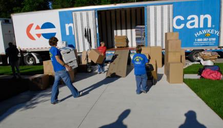 ADBNFR Family loads personal belongings on a truck