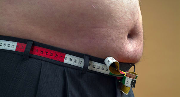 Tape measure around fat mans waist