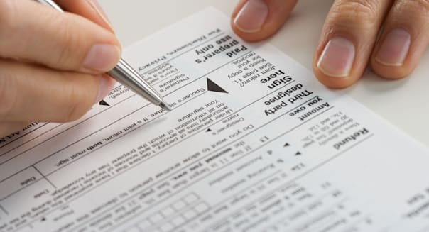 Closeup of hands with tax form