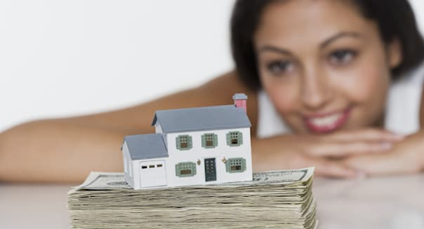 Woman looking at house savings