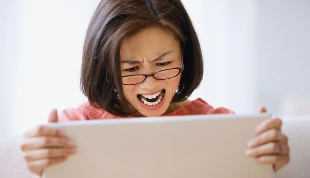 Asian woman yelling at laptop