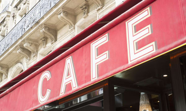 Cafe' sign awning over city street