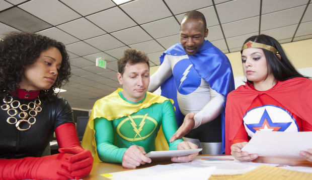 Office super heros in a meeting