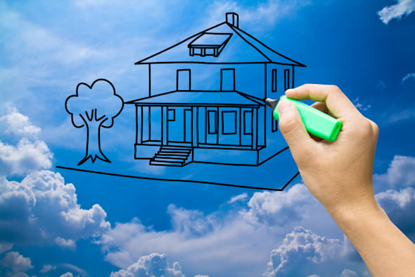 hand drawing dream home on blue ...