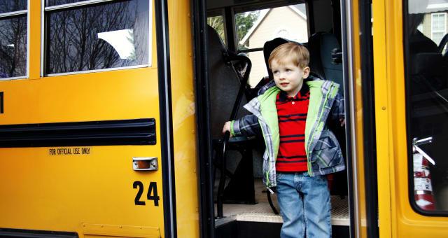 Young Boy On School Bus