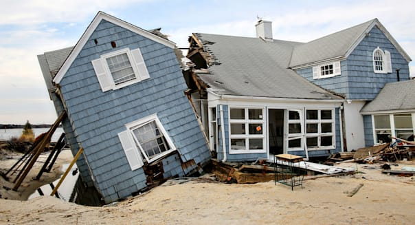 A home knocked off the foundation by Hurricane Sandy as clean up continues in the aftermath January 16, 2013 in Mantoloking, NJ.
