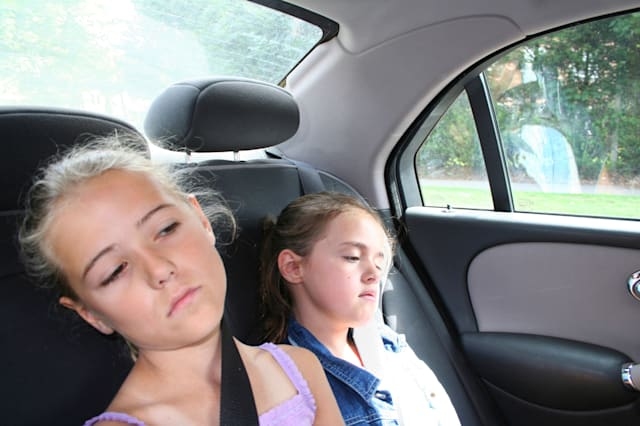 Kids bored in a car journey