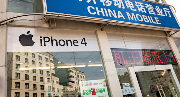 Sign in Chinese advertising the Apple iPhone and iPad at a China Mobile store in Beijing, China