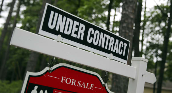 In this June 4, 2015, photo, a real estate sign is posted in front of a newly constructed luxury home in Roswell Ga. Freddie Mac reports on average U.S. mortgage rates on Thursday, June 25, 2015. (AP Photo/John Bazemore)