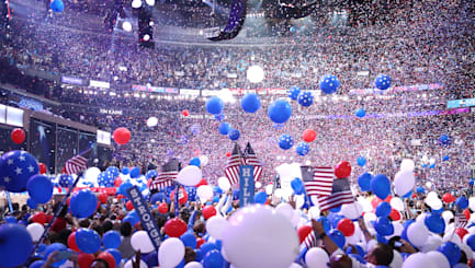Who pops the balloons at the end of US conventions?