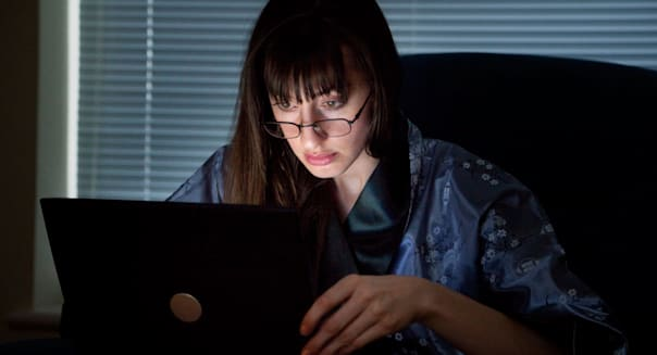 woman stressed working 24/7 with computer
