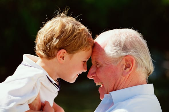 Grandfather & grandson. Old man & young 6 years old boy. Close-up profile outdoors in garden.