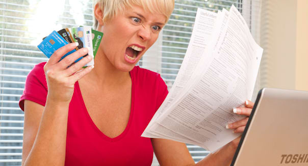 woman shocked at credit card statements