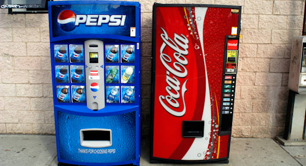 Pepsi Cola and Coca Cola vending machines side by side