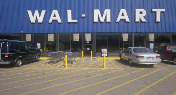 Wal * Mart Supercenter Store front entrance and parking lot in Southeast USA
