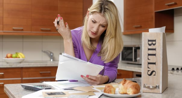 Woman checking bills