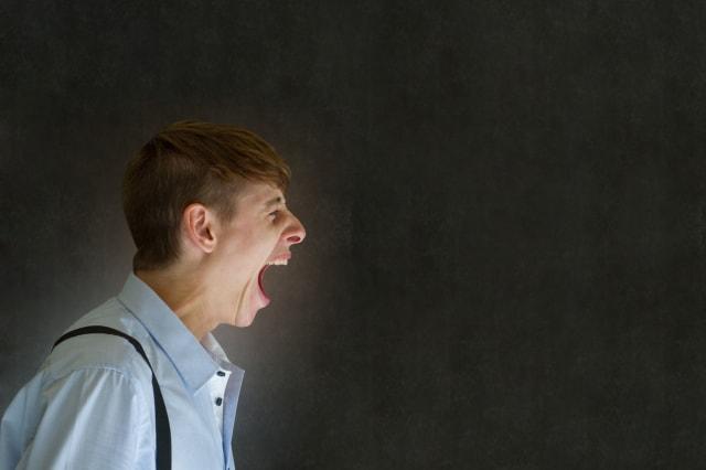 Angry big mouth man teacher