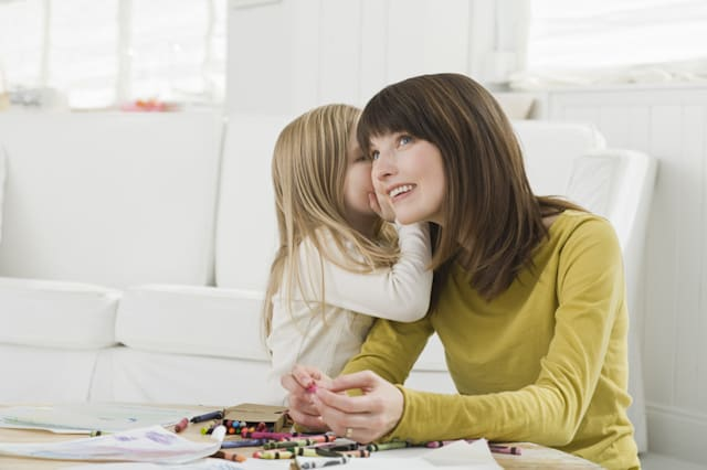 Daughter whispering to mother