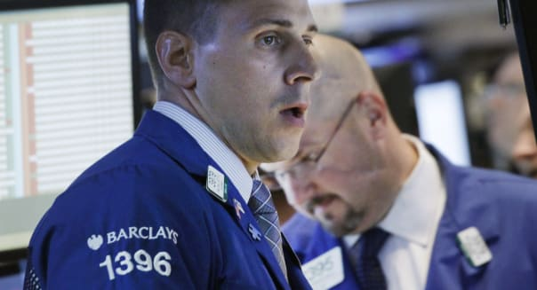 Stock traders work at the New York Stock Exchange, Monday, Aug. 19, 2013, in New York. (AP Photo/Mark Lennihan)