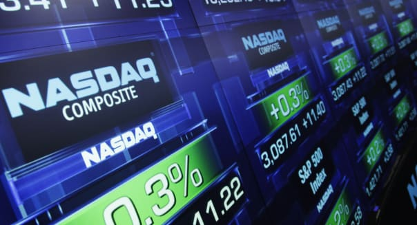 FILE - In this Tuesday, Aug. 21, 2012, file photo, stock prices are shown at the Nasdaq MarketSite, in New York. Trading was halted in Nasdaq-listed securities on Thursday, Aug. 22, 2013, because of a technical problem. The exchange sent out an alert to traders at 12:20 p.m. EDT saying that trading was being halted until further notice because of problems with a quote dissemination system. (AP Photo/Mark Lennihan, File)