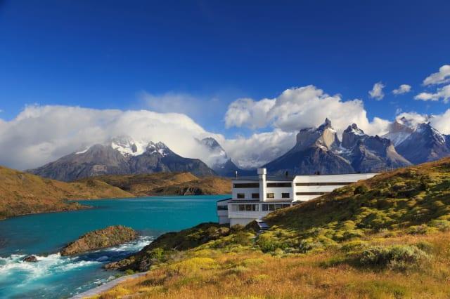 Chile, Patagonia, Torres del Paine National Park (UNESCO Site), Cuernos del Paine peaks and Luxury Hotel Explora