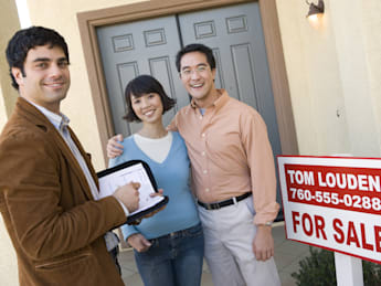 real estate agent with happy...