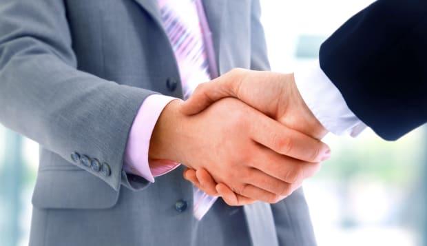 handshake isolated on blue...