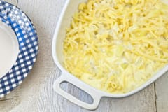 Pasta with potatoes and grated cheese in a casserole dish