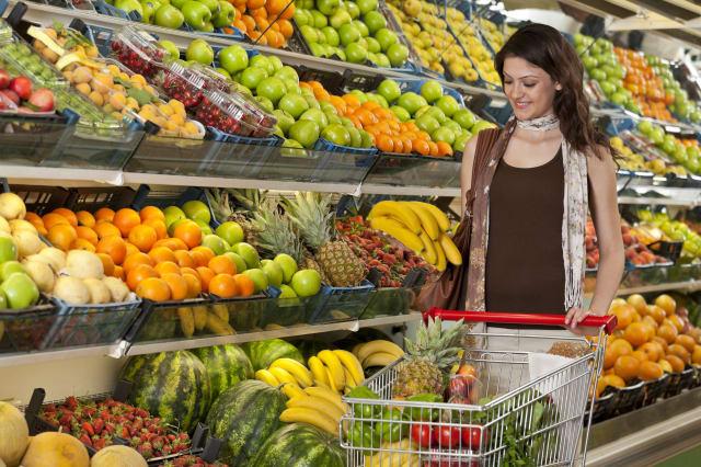 Supermarket - Woman choosing bananas