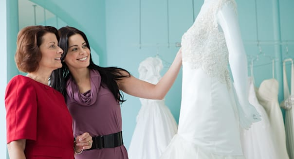 Mother and daughter looking at wedding dresses