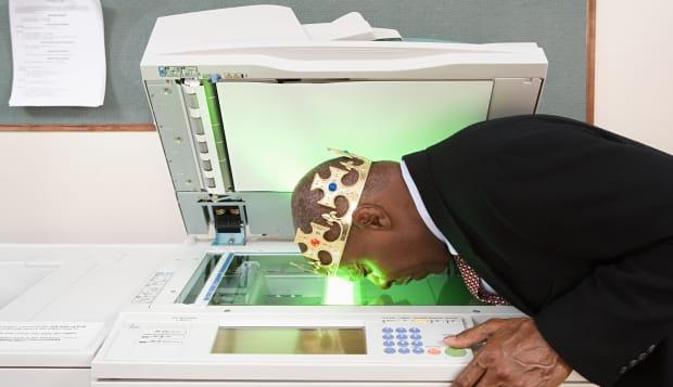 Man photocopying face