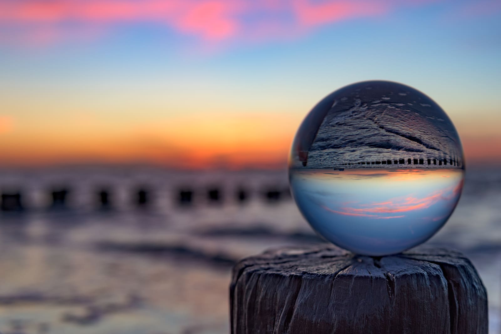Sunset with a glass globe at the beach