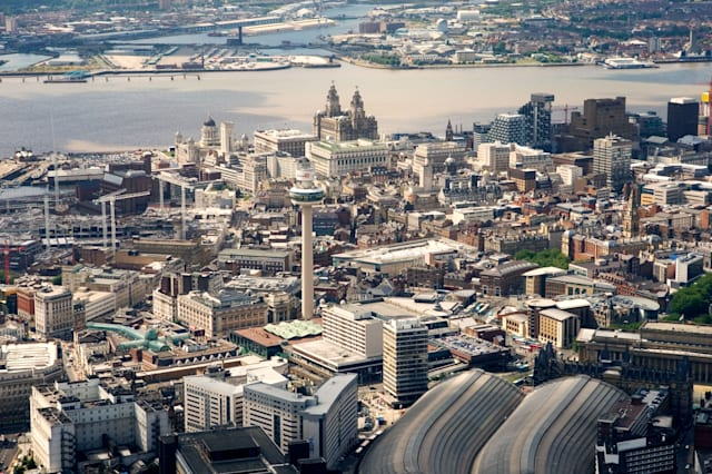 Liverpool city centre. West over Lime Street station, St. Johns Shopping Centre to the Liver Building and River Mersey, England.