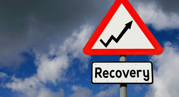 Optimistic roadsign as concept for economic recovery