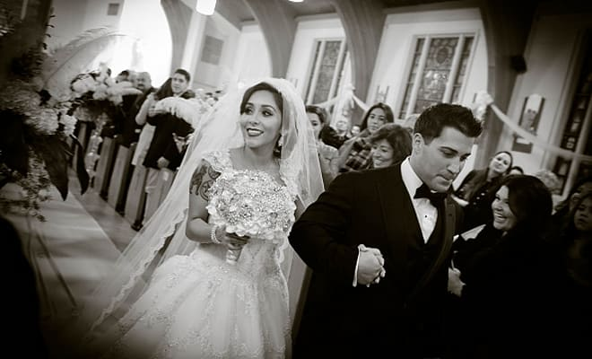 "EAST HANOVER, NJ - NOVEMBER 29:  (EXCLUSIVE COVERAGE) Nicole ""Snooki"" Polizzi and Jionni LaValle are seen druing their wedding at St. Rose Of Lima on November 29, 2014 in East Hanover, New Jersey.  Dress by Eve of Milady; head piece and veil by Boutique de Voile; earrings by Deepa Gurnani.  (Photo by NEP/WireImage)"