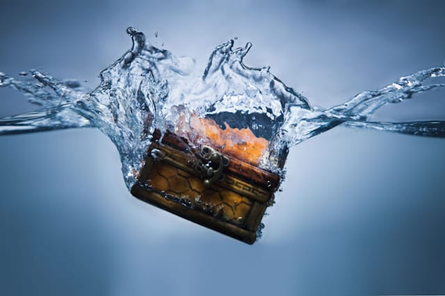 BMHPW6 Treasure chest sinking in water. Image shot 2010. Exact date unknown.  Chest; Money; Sinking; Splash; Treasure; Water; Bl