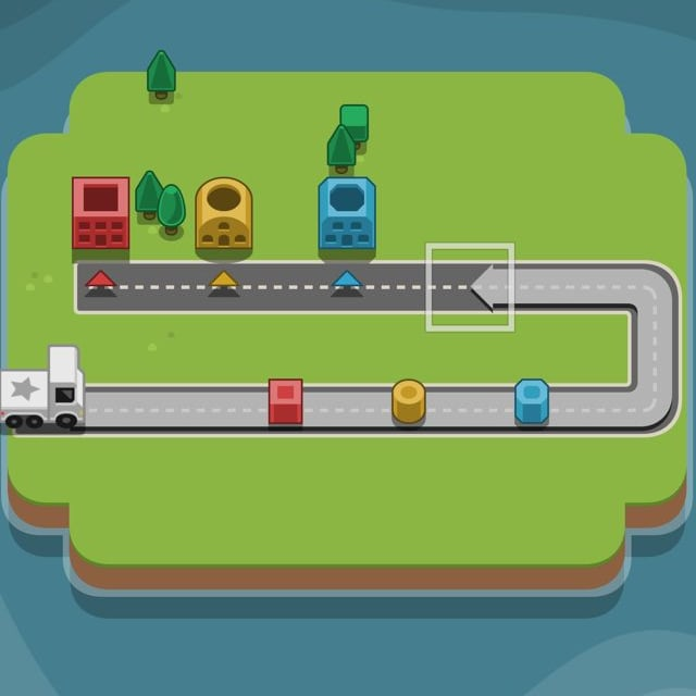 Players route a white truck toward colored blocks to be dropped off at houses in RGB Express
