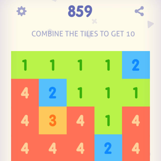 Players tap on adjacent blocks with the same number to combine them into a larger number block in Just Get 10