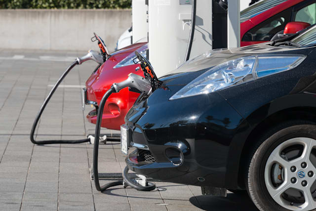 Yokohama, Japan - December 27, 2014: Electric cars, Nissan's 'Leaf', are being charged at the charging stations in front of the