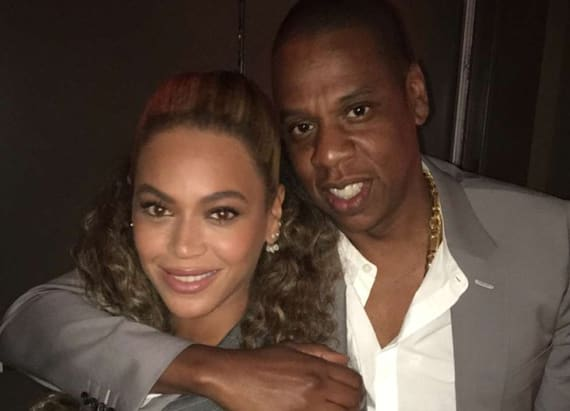 Beyoncé and Jay-Z wear the same suit