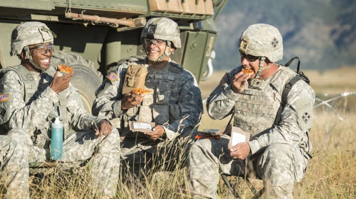 US Army soldiers eating pizza MREs