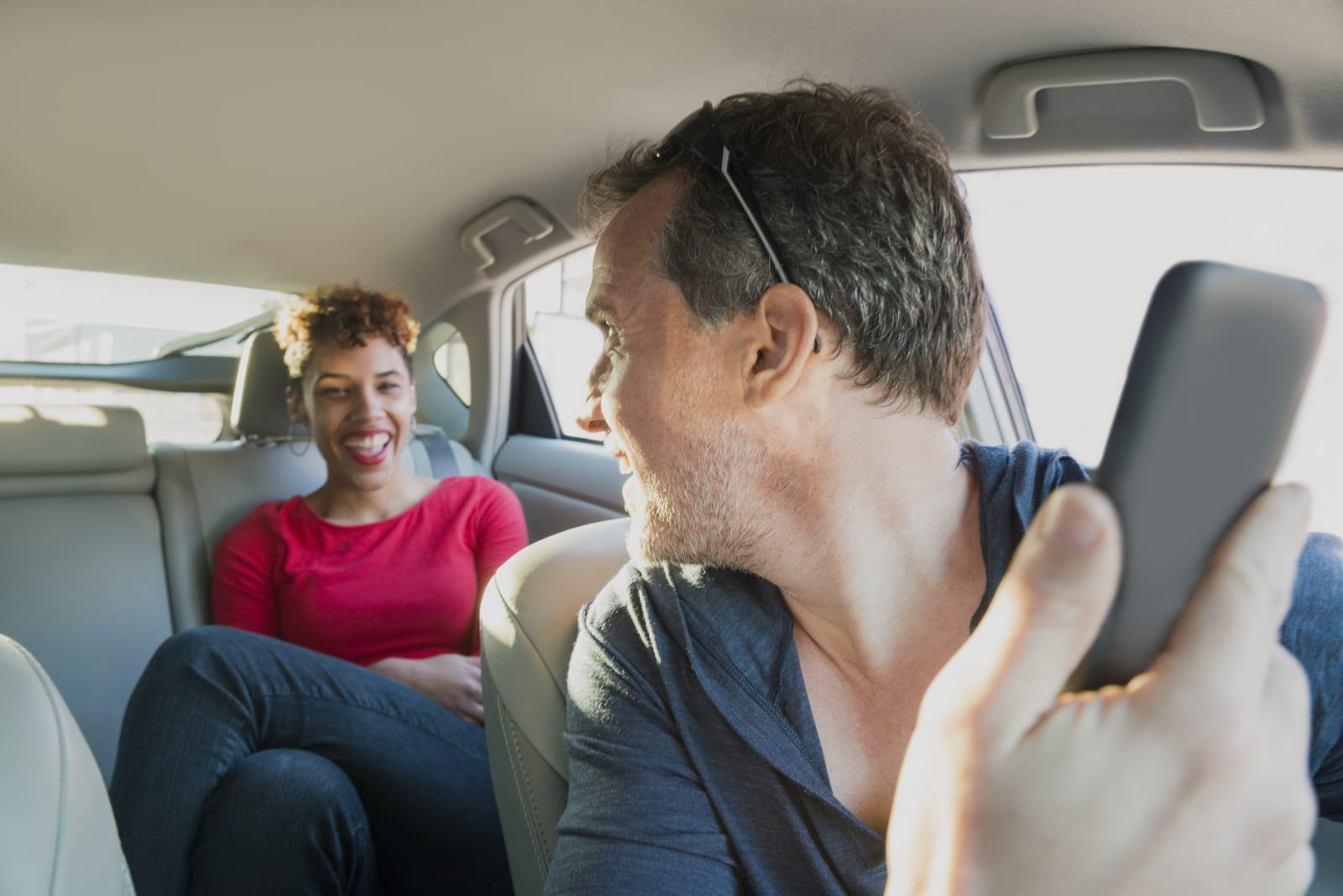 male-driver-with-mobile-phone-greets-hap
