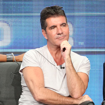 "Simon Cowell speaks onstage during the ""The X Factor"" panel discussion at the FOX portion of the 2013 Summer Television Critics Association tour - Day 9 at The Beverly Hilton Hotel  on August 1, 2013 in Beverly Hills, California.  (Photo by Frederick M. Brown/Getty Images)"