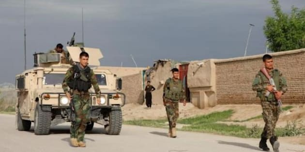 Afghan officials: Gunmen attacked army base, 100 casualties