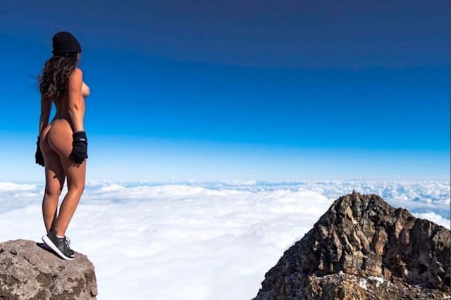 Playboy model sparks outrage over naked pose on sacred mountain