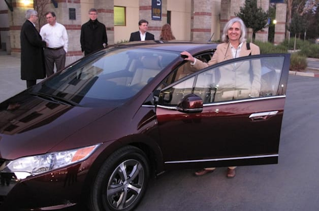 Joan Ogden, director of the Next Sustainable Transportation Pathways (NextSTEPS) program at the UC Davis Institute of Transportation Studies stands beside a hydrogen fuel cell vehicle, a Honda FCX Clarity.