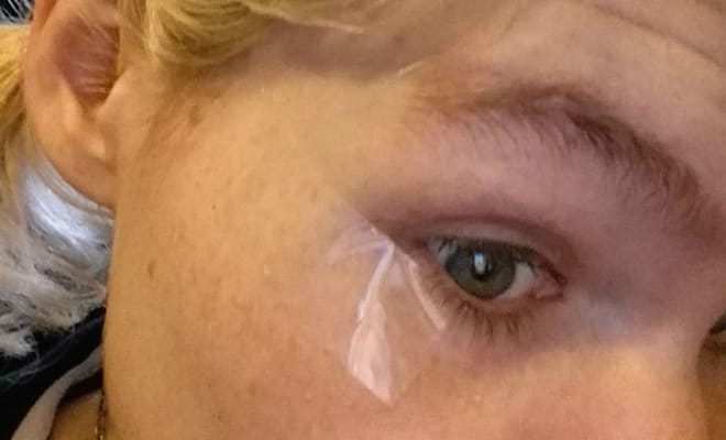 scotch tape underneath eye for beauty tutorial