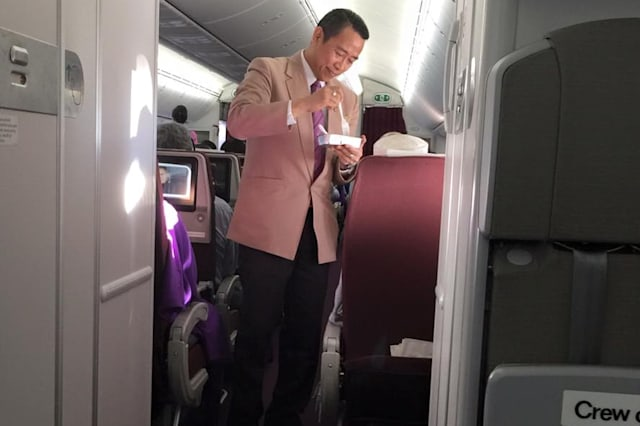 Thai Airways flight attendant praised for helping elderly man eat