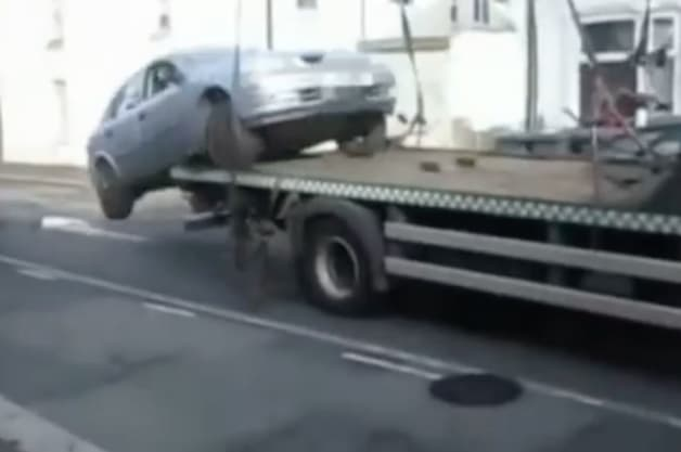 Man reverses off of tow truck